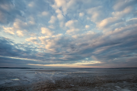 baical: Frozen Lakel. Beautiful stratus clouds over the ice surface on a frosty day. Natural background Stock Photo