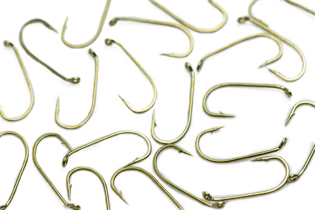A large number of fish hooks on a white background Stock Photo