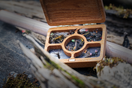 white salmon river: Box with flies made of wood. Wet flies. Fishing for a fly.
