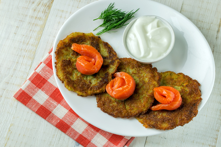 brown trout: Potato pancakes on a white plate with slices of salmon Stock Photo