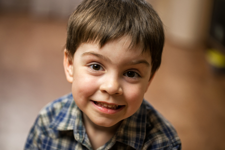 dreaminess: Boy brunette in checkered shirt with brown eyes shows class and smiles