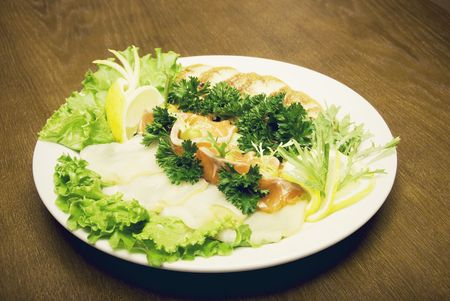 cartilaginous: Appetizer made of meat and fish served with salad on the round plate