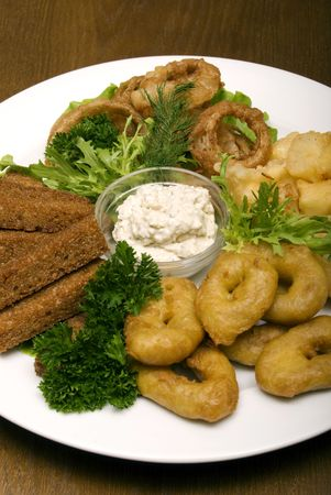 Appetizer made of fried onion, potato and bread photo