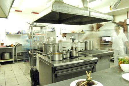 kitchen equipment: Kitchen in restaurant or canteen with personnel  Stock Photo