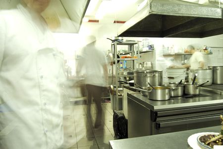 Kitchen in restaurant or canteen with personnel  Stock Photo