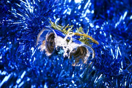 silver bells: Blue glittering  Christmas tinsel and silver bells