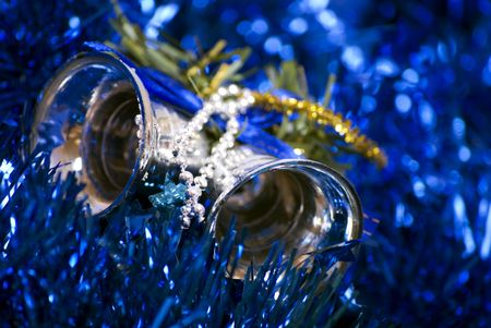Blue glittering  Christmas tinsel and silver bells  photo