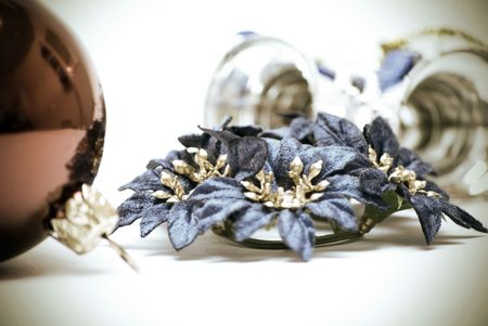 Red  Christmas ball, blue flowers and silver  bells close-up photo