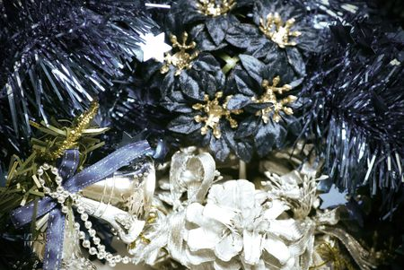silver bells: Christmas flowers, blue tinsel, silver bells  and decorative cone Stock Photo