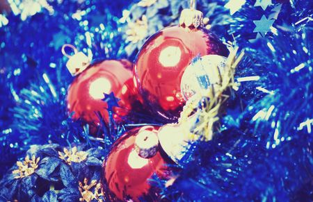 Red Christmas balls with blue tinsel and silver bell  photo