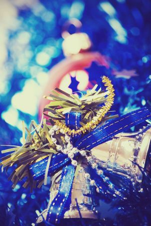 Blue glittering  Christmas tinsel and silver bells Stock Photo - 8044584