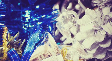 silver bells: Christmas silver bells, blue tinsel,  and decorative cone