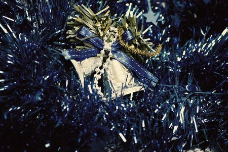 Blue glittering  Christmas tinsel and silver bells Stock Photo - 8044600