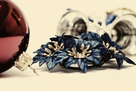 Red  Christmas ball, blue flowers and silver  bells close-up Stock Photo - 8044553