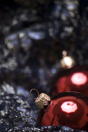 Red Christmas balls  on the sheer black material photo