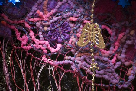 metall: Colorful textiles and hanging metall butterfly  Stock Photo