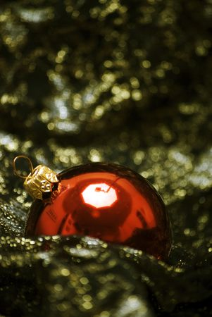 Red Christmas ball  on the sheer black material photo