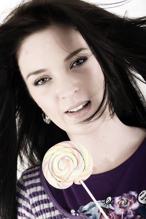 sugarplum: Portrait of a young beautiful brunette with sugarplum Stock Photo