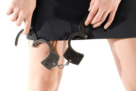 Young woman  holding handcuffs close-up photo