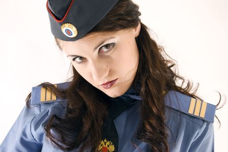 Young beautiful woman in police uniform close-up photo