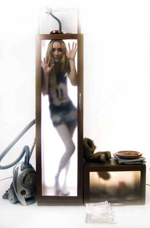 deadlock: Photo of the young girl closed behind the glass dorr of the wardrobe