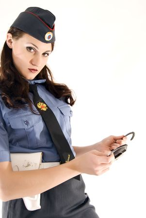 Young woman in police uniform holding handcuffs  photo