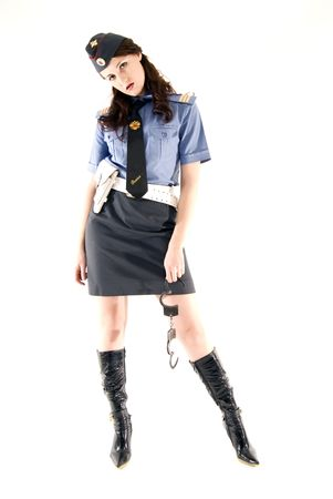 sexy police: Young woman in police uniform holding handcuffs  Stock Photo