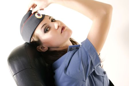Young beautiful woman in police uniform posing Stock Photo - 8269725