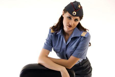 Young beautiful woman in police uniform posing photo