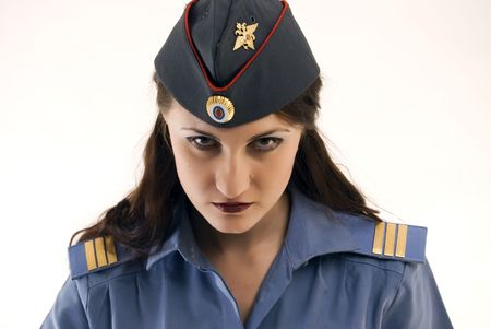 Young beautiful woman in police uniform being strict and serious photo