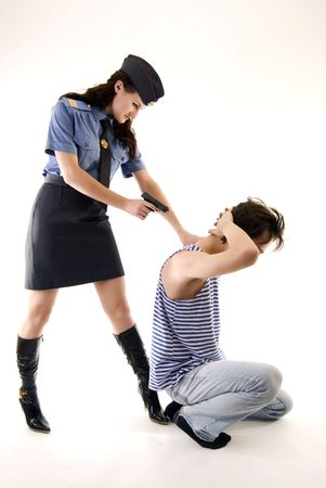 Young woman in police uniform arresting a criminal photo