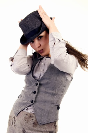 coquettish: Portrait of a young coquettish brunette in hat posing Stock Photo