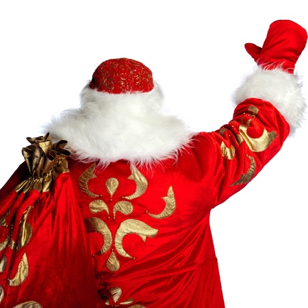 Santa Claus pointing his hand isolated over white. Photo from behind Stock Photo - 11998755