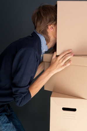 alter ego: Portrait of anonymous young man with his head inside box