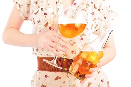 Funny oktoberfest beer holding woman isolated on white background photo