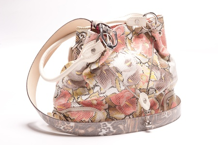 Isolated handbag with beautiful floral ornament photo