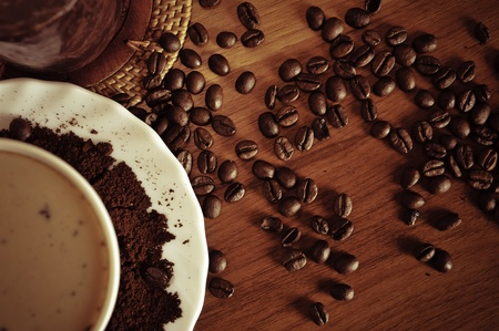 warm cup of coffee on brown background photo