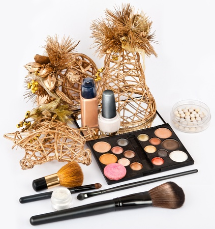 Group of makeup products isolated on white in beautiful Stillife Stock Photo - 12020719
