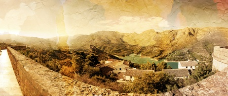 Panoramic view of beautiful mountains and lofty lake. Guadales, Spain. Old photo style photo