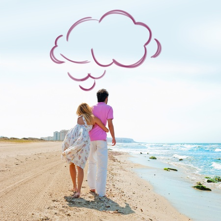 daydreaming: Couple at the beach holding hands and walking. Sunny day, bright colors. Europe, Spain, Costa Blanca. Blank cloud balloon overhead