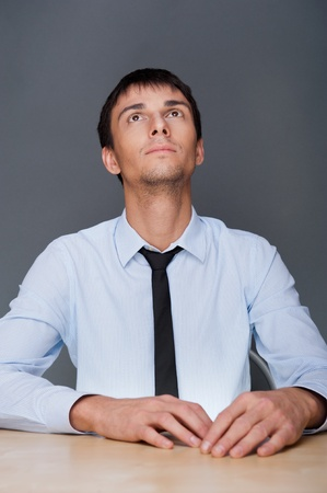 Portrait of an adult business man sitting in the office and daydreaming, planing Stock Photo - 27087462
