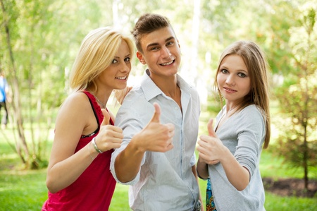 Portrait of three young teenagers laughing and having fun together. Outdoor in summer park photo