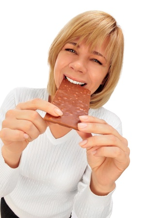Closeup humorous portrait of a beautiful adult woman holding big chocolate bar photo