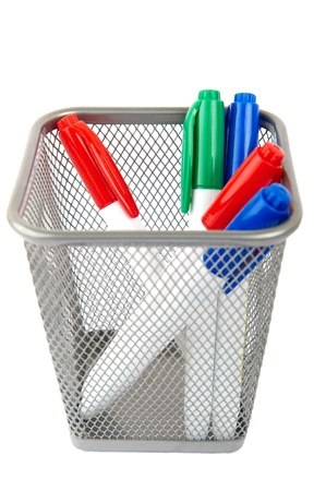 Markers for white board in basket isolated on a white background photo