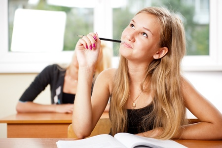 cool girl: Portrait of a young group of students paying attention in class.