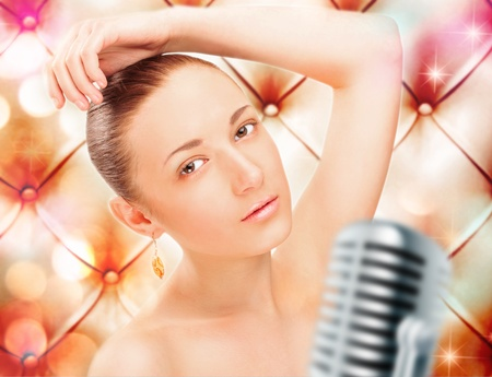 Girl Singing In Retro Microphone against vintage stylish background photo