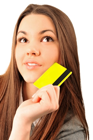 Happy blond woman holding blank credit card photo