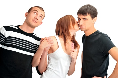 Portrait of group of people - one girl with positive pregnancy test and two men thinking about paternity photo