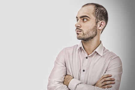 conceited: Fashion young businessman on gray background