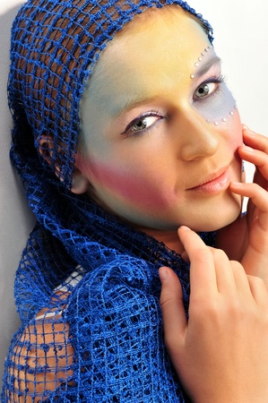 Closeup fashion portrait of cute woman with colorful bright makeup photo